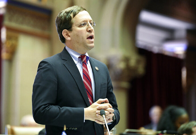 David Buchwald, D-Westchester, speaks to members of the New York state Assembly in favor of legislation that authorizes state tax officials to release, if requested, individual New York state tax returns to Congress, during a vote in the Assembly Chamber at the state Capitol Wednesday, May 22, 2019, in Albany, N.Y. (AP Photo/Hans Pennink)
