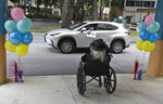 FILE- In this July 17, 2020, file photo, Frances Reaves, in car, pays a visit to her friend Margaret Choinacki, foreground, 87, who has no other family members left because her husband and daughter have died, at Miami Jewish Health in Miami. Floridians will soon be allowed to visit loved ones in nursing homes after nearly six months of vulnerable seniors being cut off from family as Gov. Ron DeSantis announced Tuesday, Sept. 1, 2020, that facilities could start a partial reopening. (AP Photo/Wilfredo Lee, File)