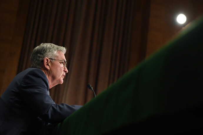 FILE - In this Feb. 12, 2020, file photo Federal Reserve Chairman Jerome Powell testifies before the Senate Banking Committee on Capitol Hill in Washington. On Wednesday, Feb. 19, the Federal Reserve releases minutes from its January meeting. (AP Photo/Susan Walsh, File)