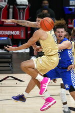 Kentucky guard Devin Askew, right, passes the ball as Georgia Tech guard Jordan Usher, left, defends during the second half of an NCAA college basketball game Sunday, Dec. 6, 2020, in Atlanta. (AP Photo/John Bazemore)