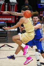 Kentucky guard Devin Askew, right, passes the ball as Georgia Tech guard Jordan Usher, left, defends during the second half of an NCAA college basketball game Sunday, Dec. 6, 2020, in Atlanta. (AP Photo/John Bazemore)