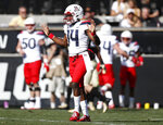 Arizona quarterback Khalil Tate, front, reacts after throwing for a touchdown against Colorado in the first half of an NCAA college football game Saturday, Oct. 5, 2019, in Boulder, Colo. (AP Photo/David Zalubowski)