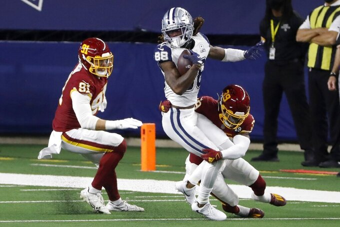 Washington Football Team's Ryan Kerrigan (91) and Jeremy Reaves (39) combine to stop Dallas Cowboys wide receiver CeeDee Lamb (88) in the second half of an NFL football game in Arlington, Texas, Thursday, Nov. 26, 2020. (AP Photo/Roger Steinman)
