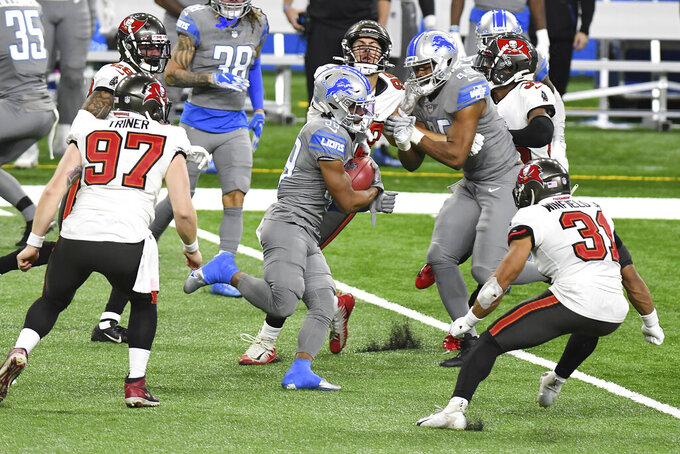 Detroit Lions' Jamal Agnew breaks through the Tampa Bay Buccaneers defense for a 74-yard punt return for a touchdown during the second half of an NFL football game, Saturday, Dec. 26, 2020, in Detroit. (AP Photo/Lon Horwedel)