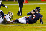 Chicago Bears quarterback Nick Foles (9) is sacked by New Orleans Saints defensive end Cameron Jordan (94) in the final minute of the second half of an NFL football game in Chicago, Sunday, Nov. 1, 2020. (AP Photo/Nam Y. Huh)