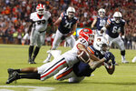FILE - In this Nov. 16, 2019, file photo, Georgia defensive back Eric Stokes (27) breaks up a pass play in the end zone intended for Auburn running back Jay Jay Wilson (42), but a pass interference call kept Auburn's drive alive during the NCAA college football game, in Auburn, Ala. o. 1 LSU will meet No. 4 Georgia in the SEC Championship. (Bob Andres/Atlanta Journal-Constitution via AP, File)
