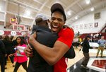 Boston University's  Walter Whyte celebrates with head coach Joe Jones after winning the NCAA Patriot League Conference basketball  championship over Colgate at Cotterell Court, Wednesday, March 11, 2020, in Hamilton, N.Y. (AP Photo/John Munson)