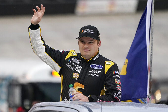 Cole Custer waves to fans before a NASCAR Cup Series auto race at Bristol Motor Speedway Saturday, Sept. 18, 2021, in Bristol, Tenn. (AP Photo/Mark Humphrey)