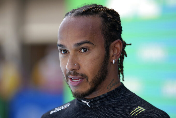 Mercedes driver Lewis Hamilton of Britain talks after he clinched his 100th pole position by clocking the fastest time in the qualifying for the Spanish Formula One Grand Prix at the Barcelona Catalunya racetrack in Montmelo, just outside Barcelona, Spain, Saturday, May 8, 2021. The Spanish Grand Prix will be held on Sunday. (AP Photo/Emilio Morenatti, Pool)