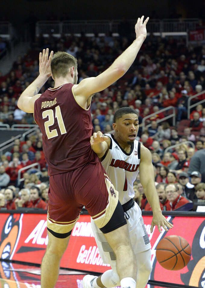 Louisville guard Christen Cunningham (1) attempts to drive around the defense of Boston College forward Nik Popovic (21) during the second half of an NCAA college basketball game in Louisville, Ky., Wednesday, Jan. 16, 2019. Louisville won 80-70. (AP Photo/Timothy D. Easley)