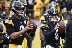 Pittsburgh Steelers quarterbacks Mason Rudolph (2) and Devlin Hodges (6) warm up before an NFL football game against the Cleveland Browns, Sunday, Dec. 1, 2019, in Pittsburgh. (AP Photo/Gene J. Puskar)