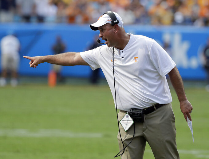 FILE - In this Sept. 1, 2018, file photo, Tennessee head coach Jeremy Pruitt directs his team against West Virginia in an NCAA college football game in Charlotte, N.C. Tennessee's home opener with East Tennessee State matches two first-year coaches and former colleagues against each other. Tennessee's Jeremy Pruitt was a defensive coordinator and ETSU's Randy Sanders was quarterbacks coach on Florida State's 2013 national championship team. (AP Photo/Chuck Burton, File)