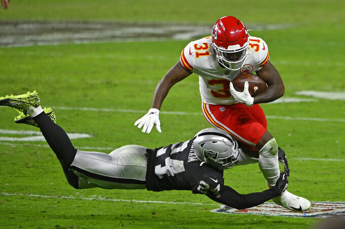 Las Vegas Raiders strong safety Johnathan Abram (24) tackles Kansas City Chiefs running back Darrel Williams (31) during the second half of an NFL football game, Sunday, Nov. 22, 2020, in Las Vegas. (AP Photo/David Becker)