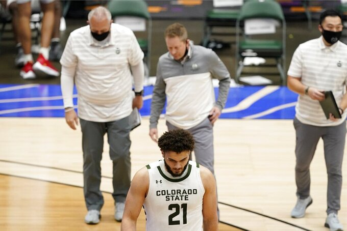 Colorado State's David Roddy (21), head coach Niko Medved, center rear, and members of his staff walk off the court following their NCAA college basketball game against Louisiana Tech in the NIT, Sunday, March 28, 2021, in Frisco, Texas. (AP Photo/Tony Gutierrez)