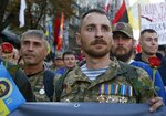 FILE In this file photo taken on Monday, Oct. 14, 2019, Ukrainian army veterans attend a rally marking Defense of the Homeland Day in center Kyiv, Ukraine. Ukraine's president sits down Monday, Dec. 9, 2019 for peace talks in Paris with Russian President Vladimir Putin in their first face-to-face meeting, and the stakes could not be higher. More than five years of fighting in eastern Ukraine between government troops and Moscow-backed separatists has killed more than 14,000 people, and a cease-fire has remained elusive.  (AP Photo/Efrem Lukatsky, File)