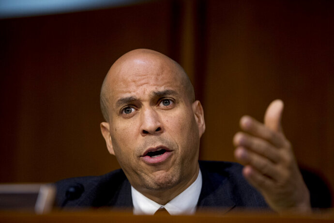 In this Jan. 15, 2019, photo, Sen. Cory Booker, D-N.J., questions Attorney General nominee William Barr as he testifies before a Senate Judiciary Committee hearing on Capitol Hill in Washington. Monday's observance of what would have been Martin Luther King Jr.'s 90th birthday is emerging as an important moment for Democrats eyeing the White House to talk about one of the most divisive issues in politics: race. (AP Photo/Andrew Harnik)