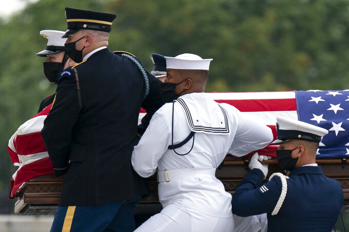 The flag-draped casket of Justice Ruth Bader Ginsburg is carried by joint services military honor guard into the U.S. Capitol to lie in state in Washington, Friday, Sept. 25, 2020. Ginsburg, 87, died of cancer on Sept. 18. (AP Photo/Carolyn Kaster)