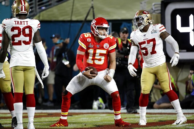 Kansas City Chiefs quarterback Patrick Mahomes (15) celebrates after scoring against the San Francisco 49ers during the first half of the NFL Super Bowl 54 football game Sunday, Feb. 2, 2020, in Miami Gardens, Fla. (AP Photo/Patrick Semansky)