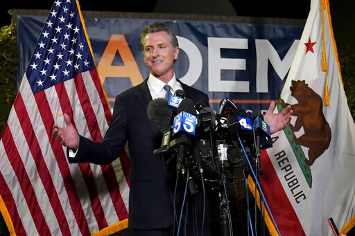 FILE - In this Sept. 14, 2021, file photo, California Gov. Gavin Newsom addresses reporters after beating back the recall attempt that aimed to remove him from office, in Sacramento, Calif. California Republicans are looking to quickly move on from a recall election that saw Gov. Newsom reinforce his political clout and add to the long list of Election Day disappointments for the state GOP. A three-day convention of party delegates that starts Friday, Sept. 24, 2021, will include its share of soul searching and finger-pointing, with the party facing the truth that Republicans have been unable to win a statewide race in California since 2006. (AP Photo/Rich Pedroncelli, File)
