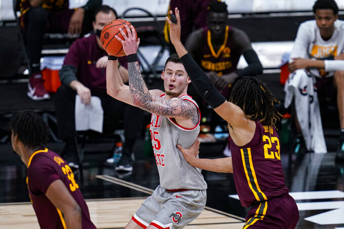 Ohio State forward Kyle Young (25) looks to shoot over Minnesota forward Brandon Johnson (23) in the first half of an NCAA college basketball game at the Big Ten Conference tournament in Indianapolis, Thursday, March 11, 2021. (AP Photo/Michael Conroy)