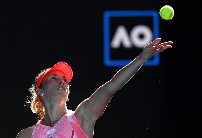 Belgium's Elise Mertens serves to Switzerland's Belinda Bencic during their third round match at the Australian Open tennis championship in Melbourne, Australia, Saturday, Feb. 13, 2021.(AP Photo/Andy Brownbill)