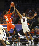 Syracuse forward Alan Griffin (0) has his shot blocked by Virginia guard Trey Murphy III (25) during an NCAA college basketball game Monday, Jan. 25, 2021, in Charlottesville, Va. (Andrew Shurtleff/The Daily Progress via AP)