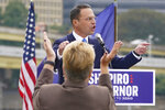 A supporter stands and applauds as Pennsylvania's Democratic attorney general Josh Shapiro speaks to a crowd during his campaign launch address for Pennsylvania governor, Wednesday, Oct. 13, 2021, in Pittsburgh. (AP Photo/Keith Srakocic)