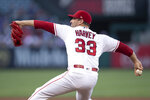 Los Angeles Angels starting pitcher Matt Harvey throws during the second inning of the team's baseball game against the Houston Astros in Anaheim, Calif., Thursday, July 18, 2019. (AP Photo/Kyusung Gong)