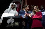 Sheikh Joaan bin Hamad bin Khalifa Al Thani, IAAF President Sebastian Coe hands over a ceremonial baton to Oregon Governor Kate Brown pose at the closing ceremony for the World Athletics Championships in Doha, Qatar, Sunday, Oct. 6, 2019. (AP Photo/Morry Gash)