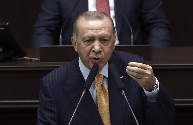 Turkey's President Recep Tayyip Erdogan addresses his ruling party lawmakers at the parliament, in Ankara, Turkey, Wednesday, Oct. 28, 2020. Erdogan threatened Wednesday to launch a new military operation in northern Syria if Kurdish militants are not cleared from areas along its border with Syria. He also said a Russian airstrike that targeted Turkey-backed Syrian rebels in Idlib earlier this week was an indication that Moscow was not looking for a lasting peace in the region. (AP Photo)