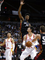 Miami Heat's Kyle Alexander (74) jumps to block a shot by China's Wang Zhelin (31) as China's Zhao Rui (1) watches during an NBA summer league basketball game Friday, July 5, 2019, in Las Vegas. (AP Photo/Steve Marcus)