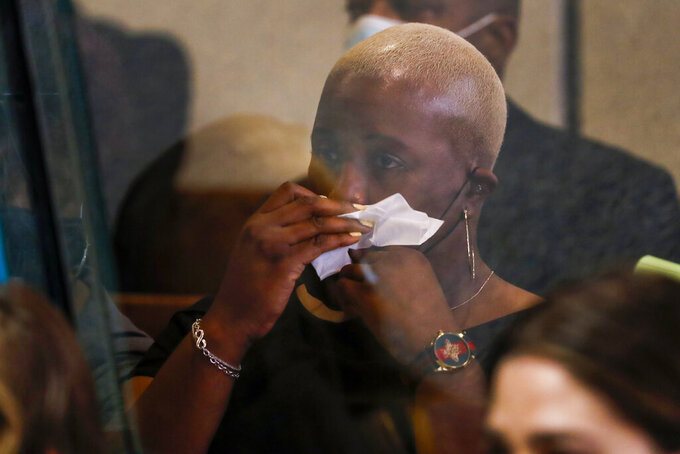 Cleopatra Cowley, mother of Hadiya Pendleton, wipes her face as she listens to prosecuting attorney Brian Holmes speak during the sentencing hearing of Kenneth Williams for the murder of her daughter, Hadiya Pendleton, at the Leighton Criminal Court Building in Chicago, Tuesday, July 20, 2021. Cook County Judge Diana Kenworthy on Tuesday ordered 29-year-old Williams to serve 35 years for first-degree murder and an additional seven years for aggravated battery. (Jose M. Osorio/ Chicago Tribune via AP, Pool)