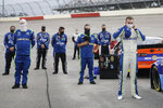 CORRECTS THE STATE TO S.C. - Driver Ty Dillon, right, stands for the national anthem before the start of the Toyota 500 NASCAR Cup Series auto race Wednesday, May 20, 2020, in Darlington, S.C. (AP Photo/Brynn Anderson)