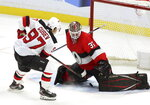 New Jersey Devils left wing Nikita Gusev (97) scores past Ottawa Senators goaltender Marcus Hogberg (35) during a shoot-out in NHL hockey action in Ottawa on Monday, Jan. 27, 2020. (Fred Chartrand/The Canadian Press via AP)