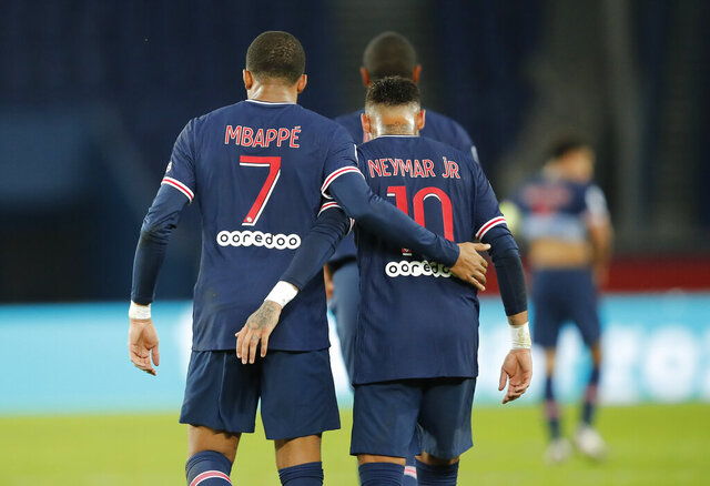 PSG's Kylian Mbappe celebrates with Neymar after scoring his side's sixth goal during the French League One soccer match between Paris Saint-Germain and Angers at the Parc des Princes in Paris, France, Friday, Oct. 2, 2020. (AP Photo/Francois Mori)