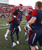 Fresno State defensive back Anthoula Kelly (6) holds up game MVP running back Ronnie Rivers (20) after they defeated Arizona State in the Las Vegas Bowl NCAA college football game, Saturday, Dec. 15, 2018, in Las Vegas. Fresno State won 31-20. (AP Photo/John Locher)