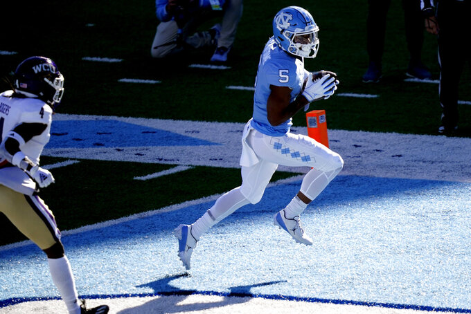 North Carolina wide receiver Dazz Newsome (5) scores a touchdown against Western Carolina during the first half of an NCAA college football game in Chapel Hill, N.C., Saturday, Dec. 5, 2020. (AP Photo/Gerry Broome)