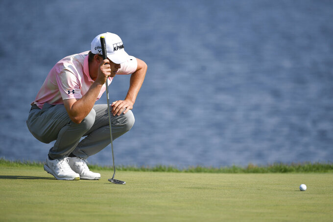 Maverick McNealy lines up a putt on the 18th hole during the third round of the 3M Open golf tournament in Blaine, Minn., Saturday, July 24, 2021. (AP Photo/Craig Lassig)