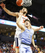 Virginia forward Jay Huff (30) blocks the shoots of Columbia guard Luke Bolster (1) during an NCAA college basketball game in Charlottesville, Va., Saturday, Nov. 16, 2019. (AP Photo/Andrew Shurtleff)