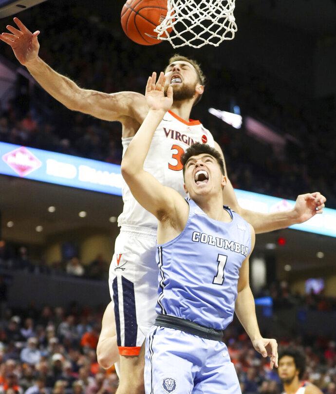 Virginia forward Jay Huff (30) blocks the shoots of Columbia guard Luke Bolster (1) during an NCAA college basketball game in Charlottesville, Va., Saturday, Nov. 16, 2019. (AP Photo/Andrew Shurtleff)