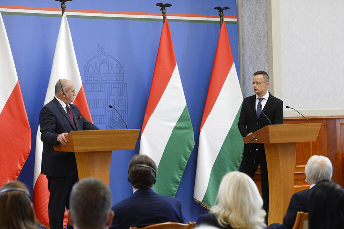 Hungarian Minister of Foreign Affairs and Trade Peter Szijjarto, right, and his Polish counterpart, Zbigniew Rau attend a joint a press conference in the Ministry of Foreign Affairs and Trade in Budapest, Hungary, Monday, Sept. 28, 2020. (Lajos Soos/MTI via AP)