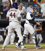 Houston Astros designated hitter Yordan Alvarez (44) stands at the plate after he struck out looking, stranding two runners and ending the game, as the New York Yankees defeated the Astros 4-2 in a baseball game Friday, June 21, 2019, in New York. Yankees catcher Gary Sanchez heads to the mound. (AP Photo/Kathy Willens)