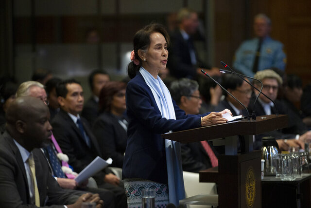 FILE - In this Dec. 11, 2019, file photo, Myanmar's leader Aung San Suu Kyi addresses judges of the International Court of Justice for the second day of three days of hearings in The Hague, Netherlands. Myanmar says it will submit a report due Saturday, May 23, 2020, outlining its claims of compliance with an order from the International Court of Justice to protect members of its Muslim Rohingya ethnic minority.(AP Photo/Peter Dejong, File)