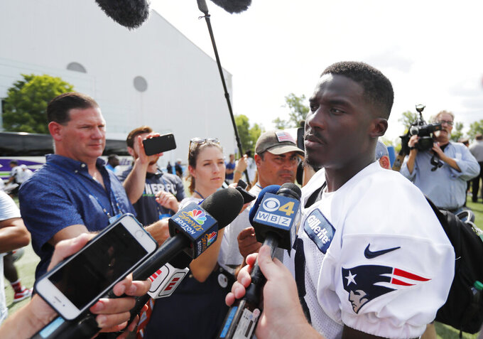 New England Patriots receiver Phillip Dorsett talks to the media after drills at the Detroit Lions NFL football training facility, Wednesday, Aug. 7, 2019, in Allen Park, Mich. (AP Photo/Carlos Osorio)