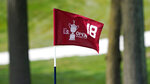 The pin flag for the 18th green flutters in the afternoon breeze during a practice round before the U.S. Open Championship golf tournament, Tuesday, Sept. 15, 2020, at the Winged Foot Golf Club in Mamaroneck, N.Y. (AP Photo/Charles Krupa)