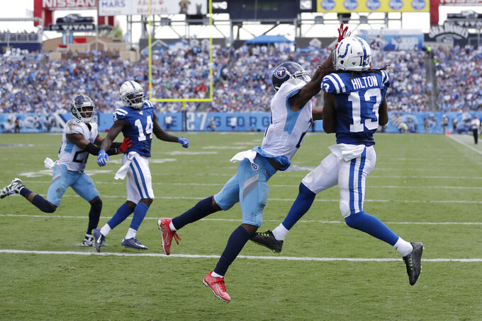 Indianapolis Colts wide receiver T.Y. Hilton (13) catches a touchdown pass as he is defended by Tennessee Titans cornerback Malcolm Butler in the second half of an NFL football game Sunday, Sept. 15, 2019, in Nashville, Tenn. (AP Photo/James Kenney)