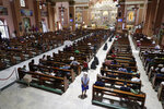 In this Feb. 10, 2020, photo, half empty pews are seen during a mass at the Minor Basilica of San Lorenzo Ruiz in Manila's Chinatown, Philippines. In a popular Catholic church in Manila, nearly half of the pews were empty for Sunday Mass. The few hundred worshippers who showed up, some in protective masks, have been asked to refrain from shaking or holding hands in prayers. (AP Photo/Aaron Favila)