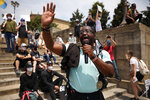 Christian Whittaker, Crisis Officer, speaks to a crowd of protestors with an open prayer at the Philadelphia Art Museum steps on Saturday, June 6, 2020, in Philadelphia. People are protesting the death of George Floyd, who died after he was restrained in police custody on May 25 in Minneapolis. (Tyger Williams/The Philadelphia Inquirer via AP)
