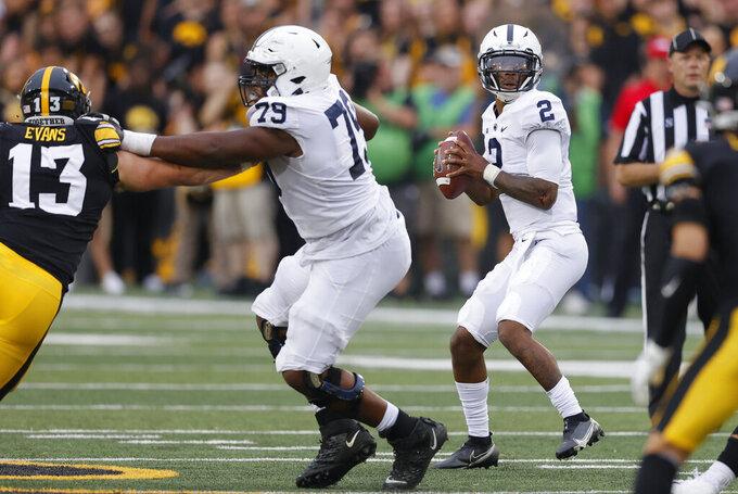 Penn State quarterback Ta'Quan Roberson (2) drops back to pass during the second half of an NCAA college football game against Iowa, Saturday, Oct. 9, 2021, in Iowa City, Iowa. Iowa won 23-20. (AP Photo/Matthew Putney)