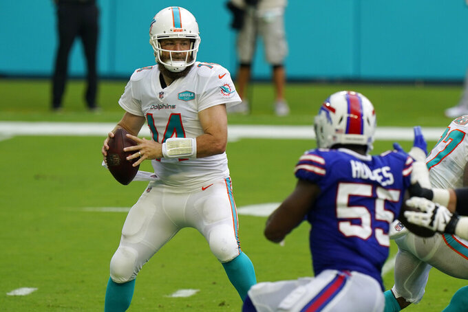 Miami Dolphins quarterback Ryan Fitzpatrick (14) looks to pass, during the first half of an NFL football game against the Buffalo Bills, Sunday, Sept. 20, 2020 in Miami Gardens, Fla. (AP Photo/Wilfredo Lee)